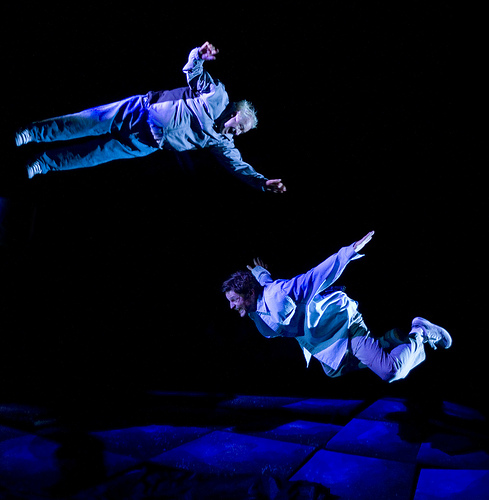 Two actors fly through the air in Realwheels' production of Skydive.